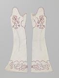White linen mitaine, embroidered in red with flower sprays and branches with serpentine scrolls
