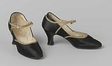 Black satin band shoe with narrow band of gold-coloured worked leather over the instep and running along the heel and …