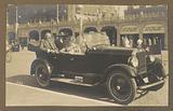 Two men and two women sitting in a car in Scheveningen
