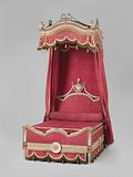 Parts belonging to four-poster bed covered with red woolen fabric, with trimmings and fringes