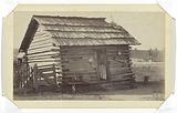 Woman Standing in the Doorway of her Wooden Cabin in or near Thomasville, Georgia, United States