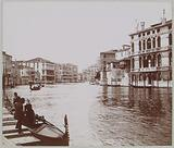 Grand Canal with palazzos in Venice, in the foreground a woman in a gondola