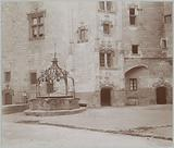 Ornamented water well at a building in France