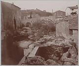 View of a bridge and a river with rocky banks, probably in the south of France