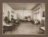 Office interior with clerks and furniture from the Meritjan sugar factory in Kediri, Java