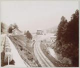 View of a railway with station and water tower in Le Lioran