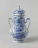 Pear-shaped covered jar with precious objects and flower sprays