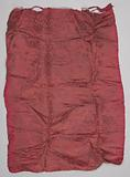 Silk damask in wine red with a pattern of a diamond division by ermine drapes