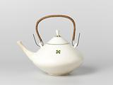 Earthenware tea kettle decorated with green and yellow squares