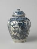 Ovoid covered jar with flowering plants in panels and ornamental borders