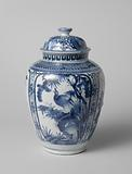 Ovoid covered jar with a bird on a rock and flowering plants in panels