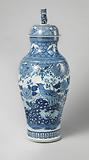 Baluster covered jar with pheasants on a rock near flowering plants and landscapes in panels