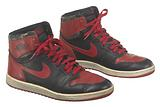 Pair of red and black Air Jordan I high top sneakers made by Nike