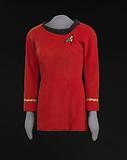 Red Starfleet uniform worn by Nichelle Nichols as Lt. Uhura on Star Trek.