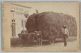 Albumen print of a man with a full hay cart