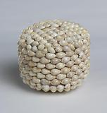 Ceremonial basket adorned with cowrie shells