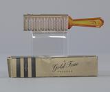 Plastic brush with box from Mae's Millinery Shop