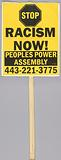 """Placard reading """"Stop racism now"""" used at Baltimore protests"""