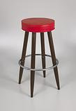 Barstool with red vinyl cover from Muse Bar, the home bar of Isaiah Muse