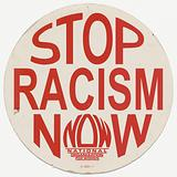 "Placard with ""STOP RACISM NOW"" message"