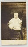 Photographic postcard of a baby in a stroller