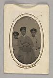 Tintype in a paper case of three unidentified young women seated