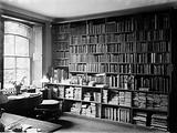 Interior of Charles Darwin study showing wall of books and windows