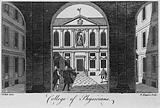 Royal College of Physicians: the courtyard, viewed through the pillars of the entrance, with gentlemen standing around