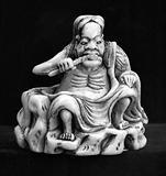 Shinno, God of medicine, chewing medicinal herb