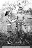 Sea Dayaks, male and female figures showing types of dress