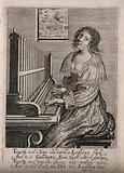 A woman sitting at an organ