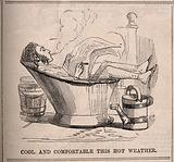 A man smoking and reading the paper fully clothed in a hip-bath