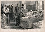 St Marylebone Infirmary, Exmoor Street, London: the Prince and Princess of Wales visiting patients in one of the wards