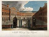 Guy's Hospital, Southwark: the entrance courtyard, with a patient being carried in on a stretcher