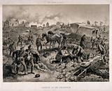 A gloomy battlefield scene with the wounded being tended to and carried away