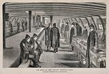 A ward on the top deck of a hospital ship with patients standing or sitting by their beds
