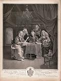 A family group of five singing around a table to the accompaniment of the violinist who is the originator of the image