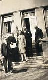 Leipzig, Germany: medical historians posing on the steps of a building: group portrait