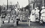University Children's Hospital, Vienna: a row of girl patients, outdoors, being measured for height