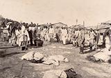 Officers washing members of the Nusserpuri camp, set up as part of the Karachi Plague Committee, India