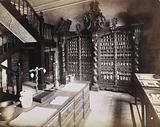An eighteenth-century apothecary's shop with intricately carved wooden showcases