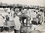 Bakery at the Indian army base in Makina, Basra, Iraq (formerly Mesopotamia): British soldiers watch the preparation …