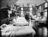A women's ward in an unidentified hospital, with elaborate decorations