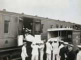 World War One: Chatham, England: loading stretchers onto a Red Cross train from an ambulance