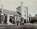 Hospital of Saint Cross, Winchester: four men standing in the courtyard