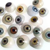 A selection of glass eyes from an opticians glas eye case