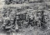 Sarawak: preserved and decorated human heads taken and strung up by Sea Dayaks