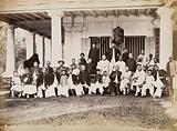 Malaya: Chinese merchants grouped outside their club house on Penang Island