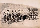 South Africa: Africans in front of a traditional kraal hut