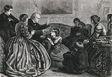 A family group of women and children sitting listening to a man telling a story